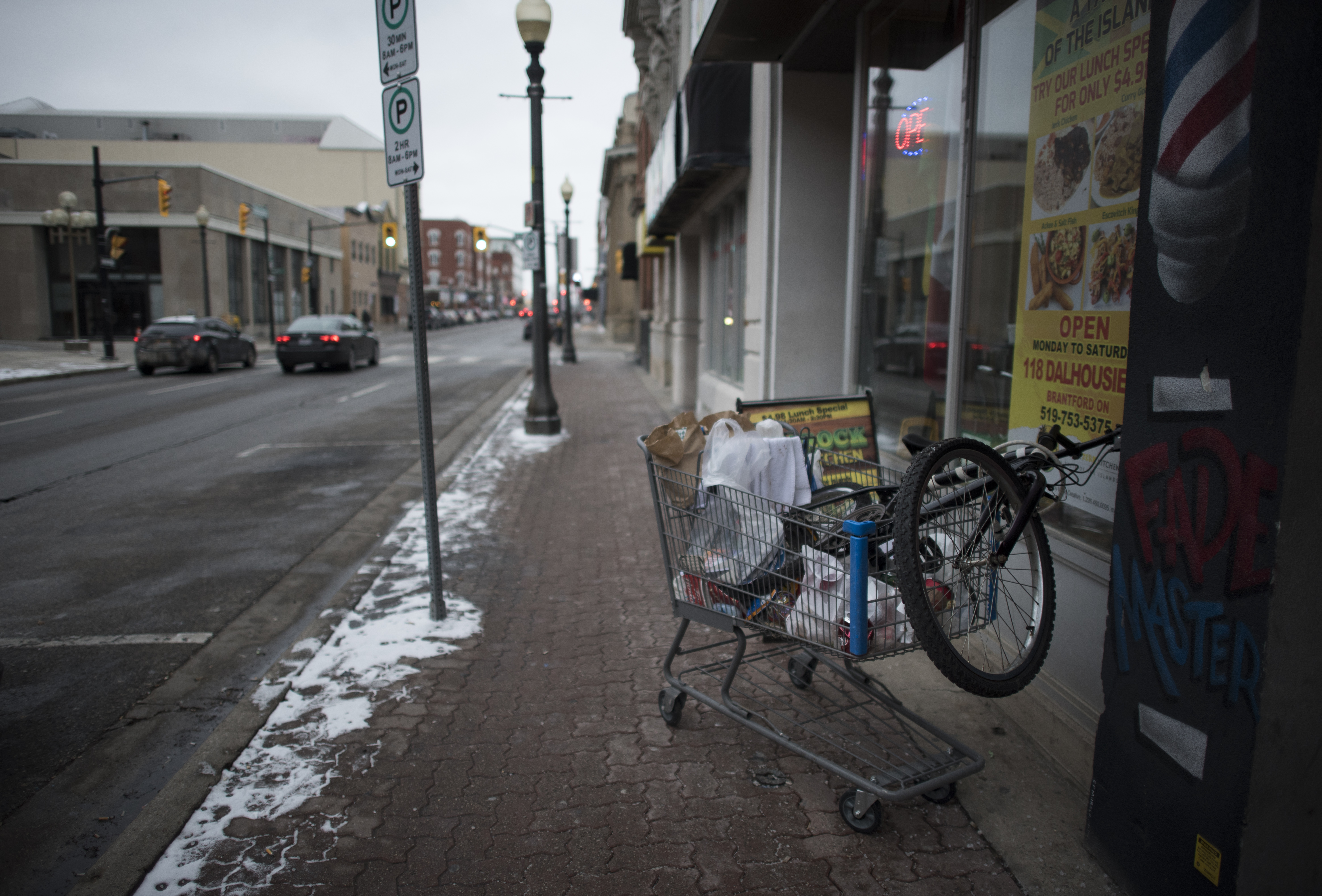A shopping cart, filled with personal belongings and items picked up around downtown, lies unattended in Brantford. Signs of the city's poverty and homelessness are especially pronounced downtown.